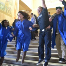 Momentum Alliance students jumping for joy after tuition equity is passed