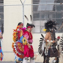 Lakota Club members, family, and spiritual leaders participate in a powwow inside the Oregon State Penitentiary