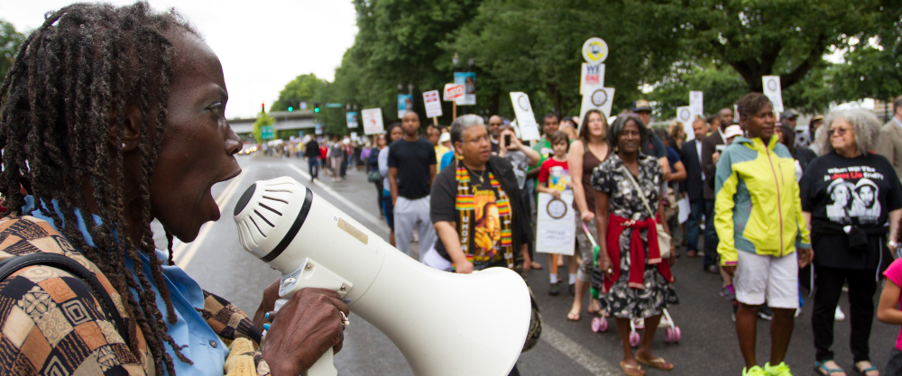 Jo Ann Hardesty encourages a crowd with a bullhorn
