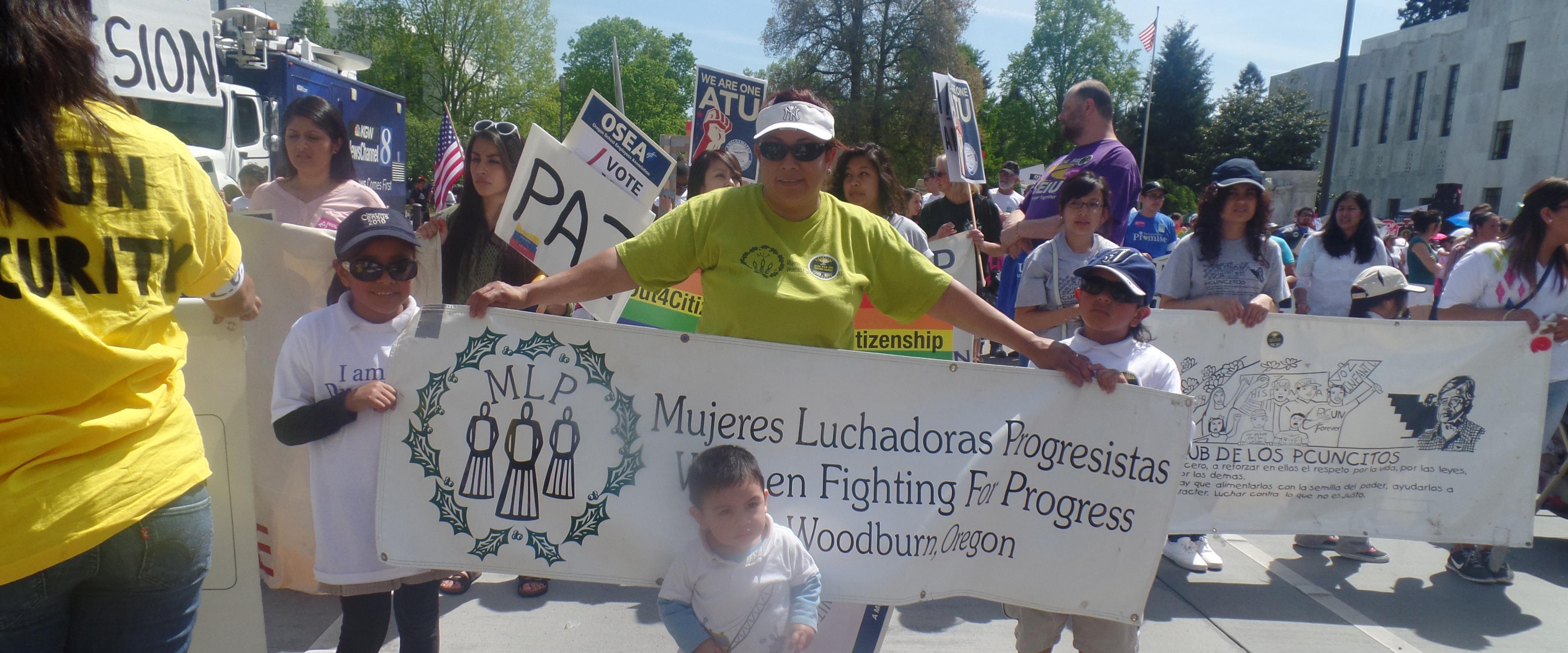 Mujeres Luchadoras Progresistas at a rally