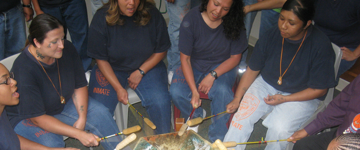 Women play a traditional Native American drum
