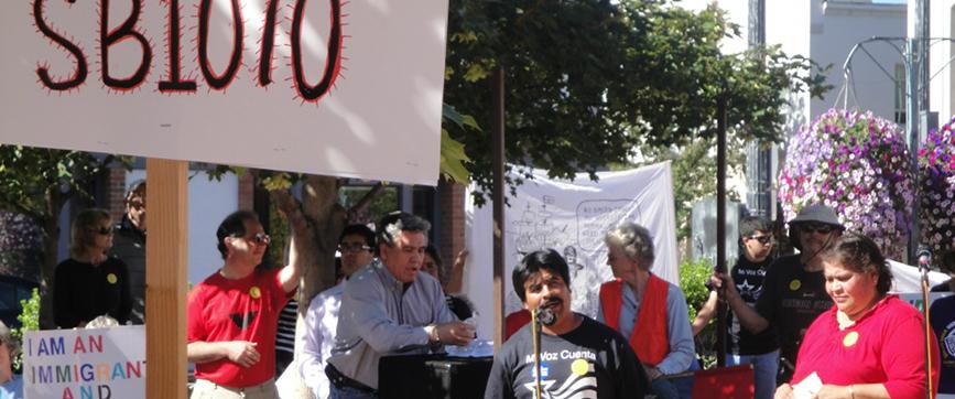 A man giving a speech at a rally