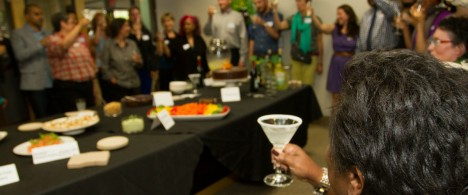 Everyone raises their glass at an MRG event