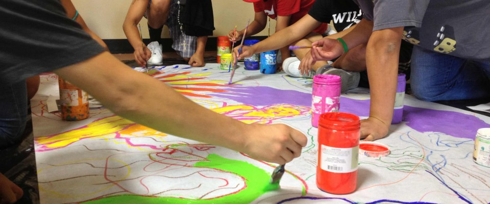 Youth create a mural with our partner Instituto In Xocitl In Cuicatl Art and Culture.