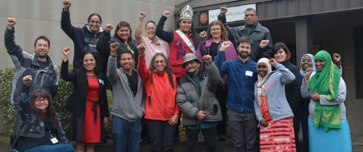 MRG activist led grantmakers celebrate a hard days work. All in a group with their hands raised.