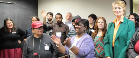 A group of people celebrate with Sharon Gary-Smith at 2015 Open House