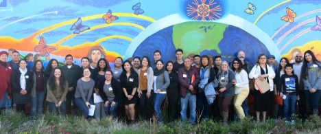 CAPACES members in front of mural in Woodburn