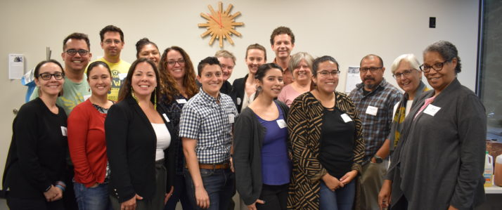 A group of Seeding Justice staff and board smile for a group photo.